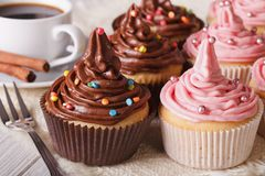 Delicious cupcakes and coffee on the table. Horizontal close-up Royalty Free Stock Photo