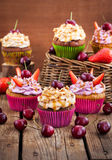 Delicious cupcakes decorated with caramel and fresh berries Stock Photo