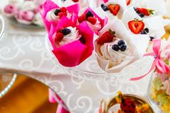 Delicious cupcakes decorated with juicy berries macro royalty free stock photo