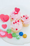 Delicious cupcakes. With hearts decoration for valentines day Stock Image