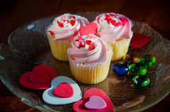 Delicious cupcakes. With hearts decorations for valentines day Royalty Free Stock Photos
