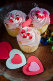Delicious cupcakes. With hearts decorations for valentines day Stock Images