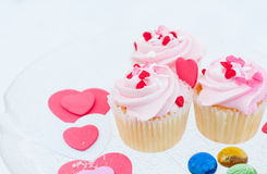 Delicious cupcakes. With hearts decorations for valentines day Stock Photo