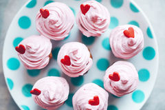 Delicious Cupcakes with Hearts. Delicious pink Cupcakes with Hearts top view Stock Photos