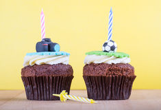 Delicious cupcakes on table Stock Images