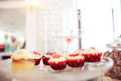 Delicious cupcakes. On table in a candy bar Stock Image
