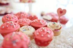 Delicious cupcakes. On table in a candy bar Stock Photos