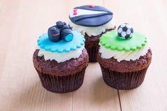 Delicious cupcakes on table Stock Photos