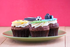 Delicious cupcakes on table Stock Photography