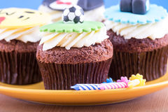 Delicious cupcakes on table Stock Photo