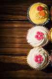 Delicious cupcakes on a table Royalty Free Stock Image