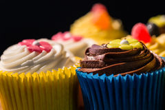 Delicious cupcakes on a table Stock Photography