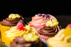 Delicious cupcakes on a table Royalty Free Stock Photos