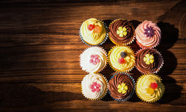 Delicious cupcakes on a table Stock Images