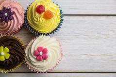 Delicious cupcakes on a table Royalty Free Stock Photo