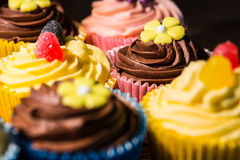 Delicious cupcakes on a table Royalty Free Stock Images
