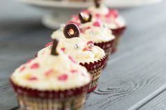 Delicious Cupcakes for Valentine Day with Beautiful Sprinkles, Close up Stock Photo