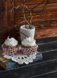 Delicious cupcakes on a wooden table. Tea time. Royalty Free Stock Photo