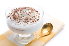 Delicious curd dessert with grated chocolate over. Napkin on a white background stock image