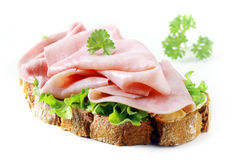 Delicious cured ham slices on rye bread Stock Photography