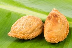 Delicious curry puffs on banana leaf Stock Photos
