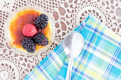 Delicious custard with raspberries and spoon Royalty Free Stock Images