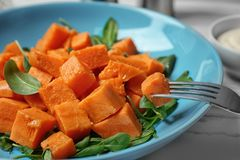 Delicious cut sweet potato on plate. Closeup stock photos