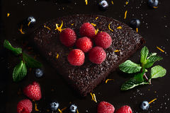 Delicious dark chocolate cake with raspberries. Top view.  Stock Image