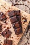 Delicious dark chocolate with cocoa powder Stock Photos