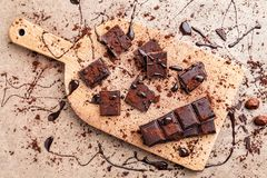 Delicious dark chocolate with cocoa powder Royalty Free Stock Photography