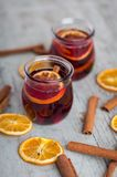 Cinnamon tea with orange peels and sticks red mulled wine hot pu Stock Image