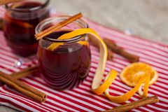 Cinnamon tea with orange peels and sticks red mulled wine hot pu Royalty Free Stock Photography