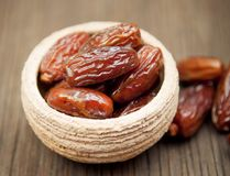 Delicious dates in small bowl Royalty Free Stock Photography