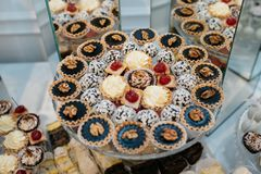 Delicious decorated candy bar, sweets on tables for wedding reception Royalty Free Stock Photos