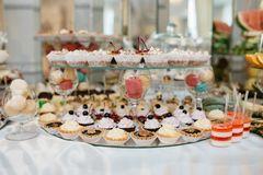 Delicious decorated candy bar, sweets on tables for wedding reception Stock Photography