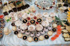 Delicious decorated candy bar, sweets on tables for wedding reception Royalty Free Stock Photography