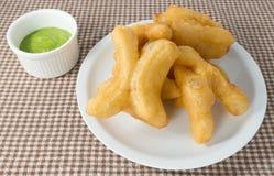 Delicious Deep Fried Doughstick with Pandan Custard Dip Stock Photo