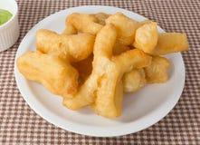 Delicious Deep Fried Doughstick with Pandan Custard Dip Royalty Free Stock Photo