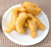 Delicious Deep Fried Doughstick on A White Dish Stock Photos