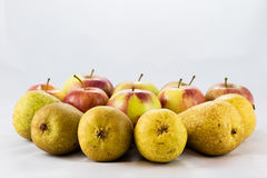 Delicious, delicious ripe apples and pears on a white background Royalty Free Stock Images