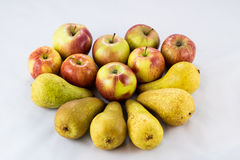 Delicious, delicious ripe apples and pears on a white background Royalty Free Stock Image