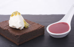 Delicious Dessert. Chocolate souffle cake with mascarpone and passion fruit, and raspberry coulis Stock Photography