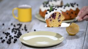 Delicious dessert black currant, sweet delicious holiday cake with black currant and lemon glaze on a table in a rustic. Style stock video