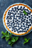 Delicious dessert blueberry tart with fresh berries and whipped cream, sweet tasty cheesecake, berry pie Stock Photography