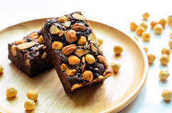 Delicious dessert brownies on wooden plate Stock Photo