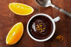 Delicious dessert from dark chocolate mousse with orange slice decorated citrus peel Royalty Free Stock Image