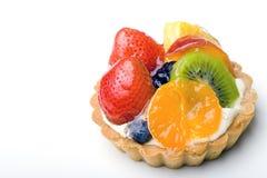 Delicious dessert fruit tart pastry with cream. Strawberry, kiwi, tangerine, pineapple delicious dessert fruit tart pastry with whipped cream layer stock image
