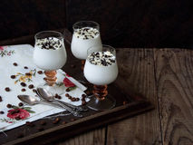 Delicious dessert in a glass. On a wooden background royalty free stock images