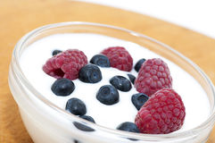 Delicious dessert made of yoghurt and ripe berries. (raspberry and blueberry royalty free stock image