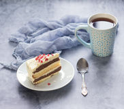 Delicious dessert. A piece of cake and cup of tea Stock Images